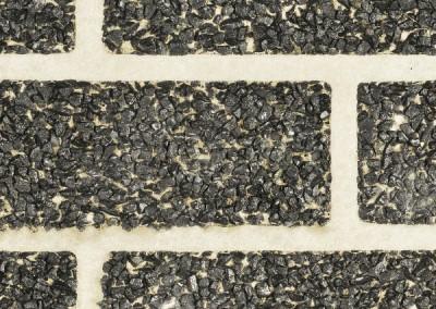 BSM Noir Ebene op grijze voeg, behandeld met Oxifilm 25.
